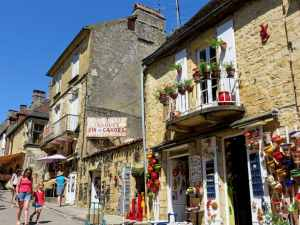 Market street in Domme, France, Perigord, Dordogne valley, handcrafts