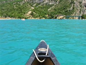 Lake of Sainte-Croix, Gorges du Verdon, Provence, France, emerald waters, canoe, bridge in the distance