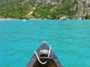 Lake of Sainte-Croix, Gorges du Verdon, Provence, France, emerald waters, canoe, bridge in the distance