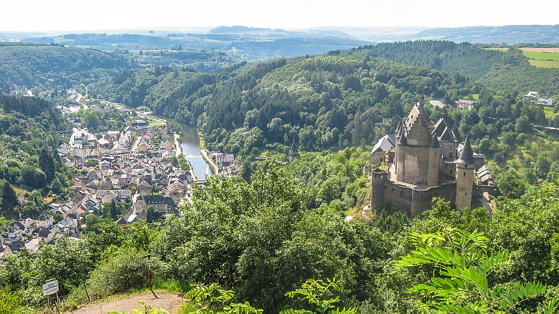 bird view on a river and a town with a castle, Vianden and Vianden Castle in Luxembourg