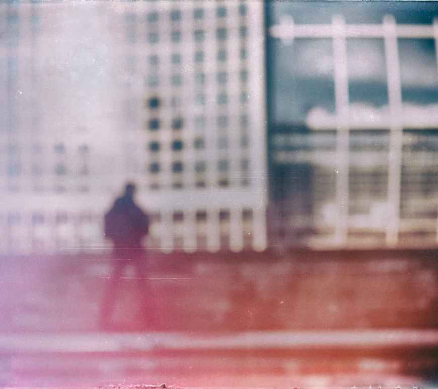 film photography of aman and buildings