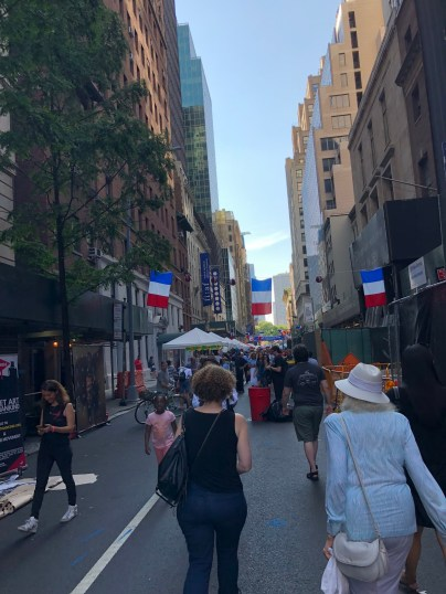 French-American citizens and French tourists celebrated Bastille Day and their FIFA win in a random street by Central Park. Random celebrations and closed off streets were expected in New York. (Photo/ Bella Ramirez)