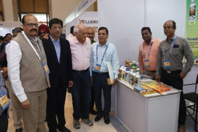 Shri H. S. Vyas along with other delegates visiting stalls