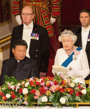 The Duchess of Cambridge and Chinese President Xi Jinping listen as Britain's Queen Elizabeth II speaks at a state banquet in the Ballroom at Buckingham Palace, London, on the first day of the state visit to the Britain, Tuesday Oct. 20, 2015. (Dominic Lipinski/Pool Photo via AP)