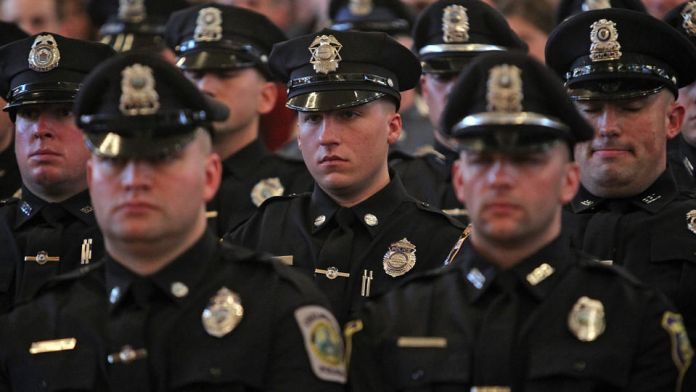 Boston - MA- 12/18/2012 - Graduates stand at attention during the graduation of the Thirtieth Municipal Police Officers Class at Faneuil Hall.   Staff Photo by Matt Stone