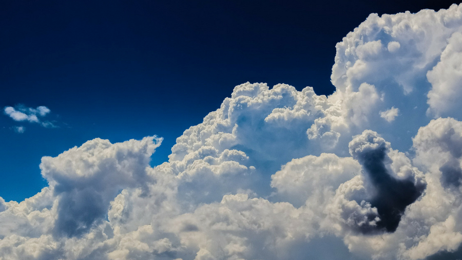 photo of white clouds against a blue sky
