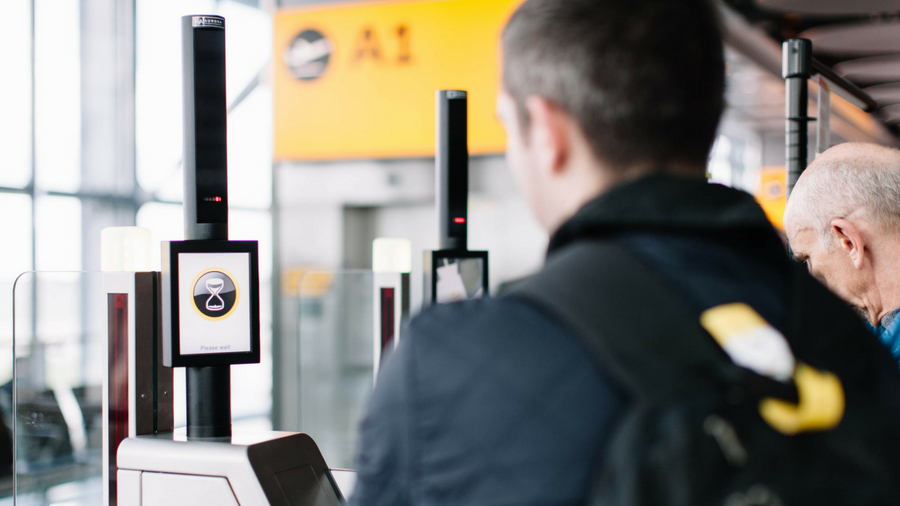 Passenger using a face scanner at a security gate