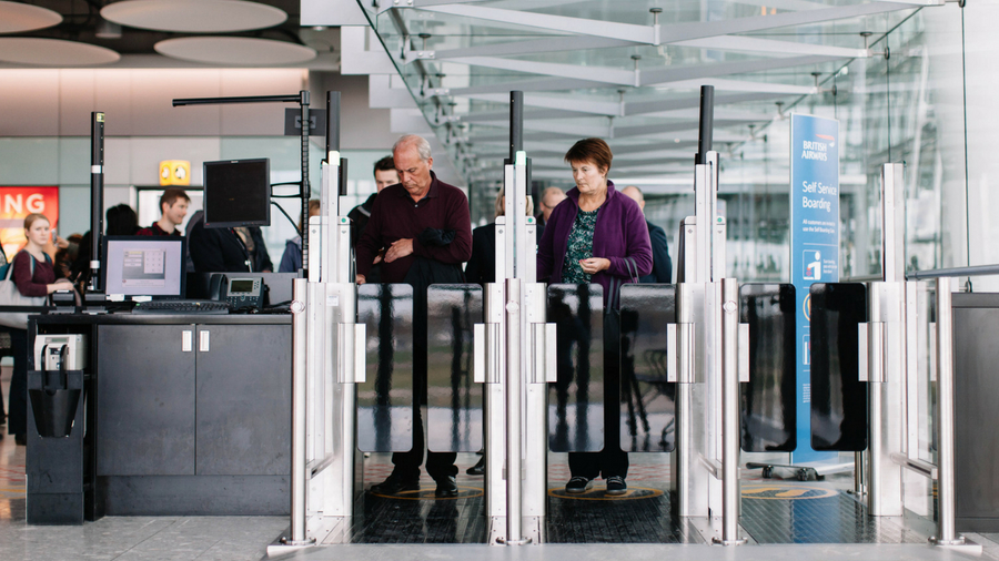 Passengers using security gates at an airport