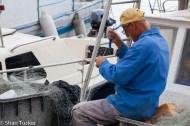 Fisherman mending his nets, Rovinj, Croatia