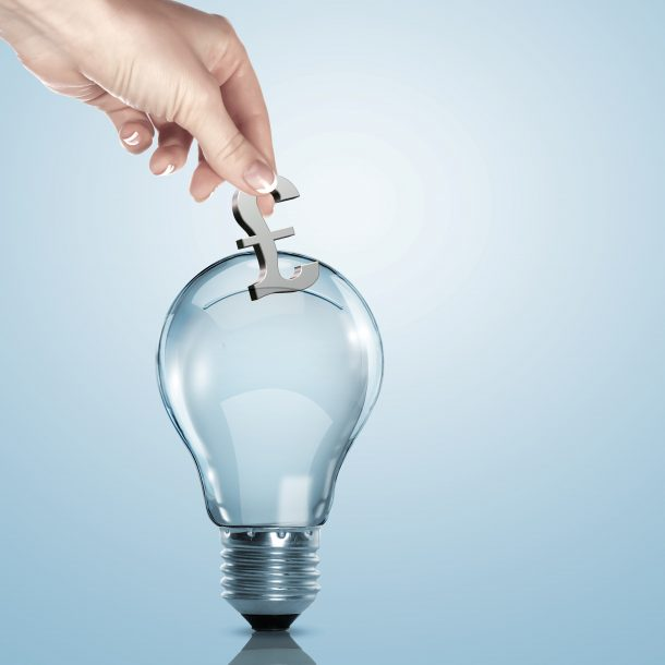 Hand putting a pound sign into a lightbulb