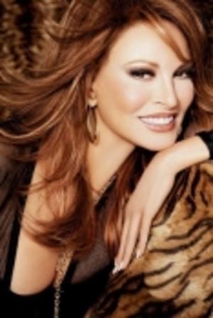 Her light brown hair cascading below her shoulders, looking great,