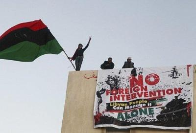 Libyan demonstrators flying the Kingdom of Libya flag, in the main square of Benghazi on 28 February 2011.
