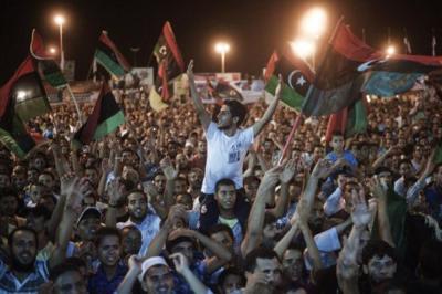 Libyans celebrated as the end of Qaddafis regime seemed near. [Gianluigi Guercia/AFP]