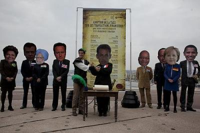 At an action this week, Robin Hood visited G-20 leaders. Photo and action by Oxfam International.