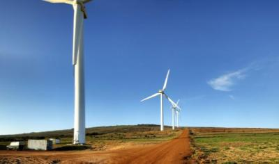 A wind farm outside Cape Town, South Africa. A new African energy initiative in the U.S. Congress promotes an appropriate mix of power solutions in Africa, but it leaves the door wide open to fossil fuels. (warrenski/Flickr)