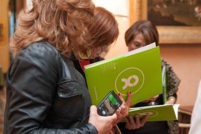 Women looking through folders with Oxfam logo