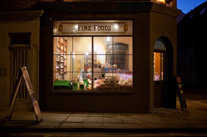 Small food shop lit at night