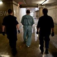 prison-guards-inmate-jail