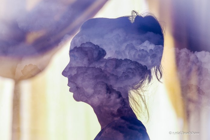 woman-silhouette-clouds-shadow