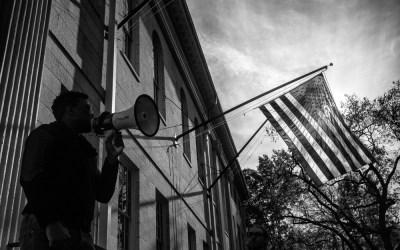 student-college-campus-free-speech-american-flag-loud-speaker