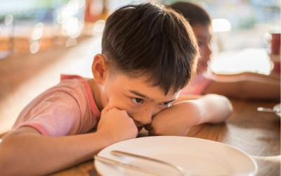 child with an empty plate