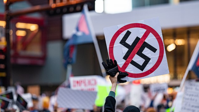 A protester holding a 45 sign outside a Donald Trump for President campaign rally at the Target Center arena in downtown Minneapolis, Minnesota, on October 10, 2019.