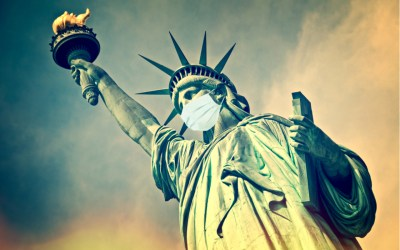 Statue of Liberty wearing a surgical mask.