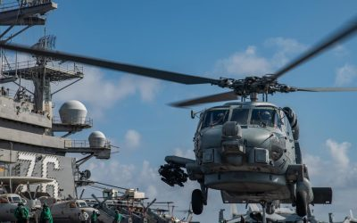 Military Budget - United States Navy Helicpoter launches from USS Ronald Reagan