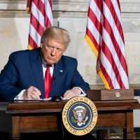 tax-taxation-trump signing a document
