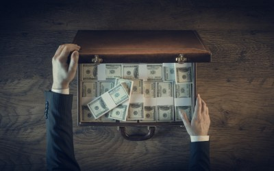 wealth inequality-picture shows a briefcase full of one hundred dollar bills