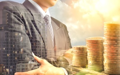 Businessman and stack coins and building shadow success business financial and tax season under the sky and sunlight soft focus