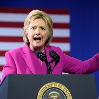Hillary Clinton makes a pointing gesture as she delivers a speech at a campaign event with US president Barack Obama
