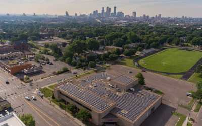 Cooperative Energy Futures: Shiloh Temple community solar garden with downtown Minneapolis in the background.