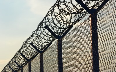 private prison barbed wire fence ice detention corecivic geo group