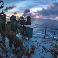 U.S. military firing .50-caliber machine gun in the philipine sea to depict U.S. militarism
