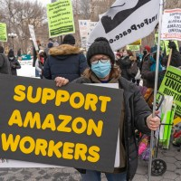 person holding a sign supporting bessemer alabama amazon warehouse union drive - protecting the right to organize (PRO) Act