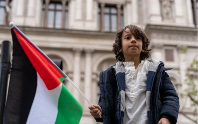 Young protesters wave Palestinian flags during the Save Sheikh Jarrah protest in front of 10 Downing Street