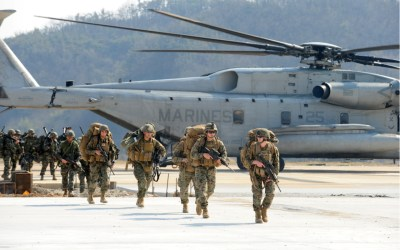 U.S. military soldiers exiting a plane and running toward an objective