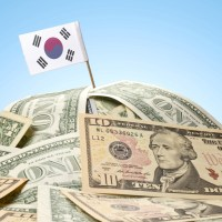 mountain of U.S. dollars with a south korea flag on top