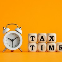clock with the words tax time