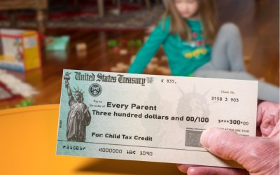 parent holding a check for the child tax credit