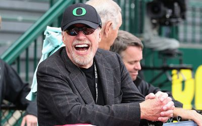 phil knight wearing a nike hat