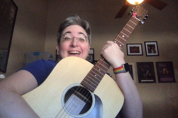 Me being super happy and hugging my new guitar.