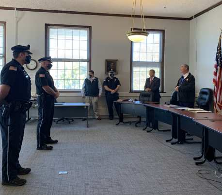 Two Ipswich Police Officers were honored during a private ceremony at the Ipswich Town Hall on Thursday, Nov. 5 for their life saving efforts over the summer. From left: Officer Brian Murphy, Lt. Jonathan Hubbard, Town Manager Tony Marino, Chief Paul Nikas, Sen. Bruce Tarr and Rep. Brad Hill. (Photo courtesy of the Ipswich Police Department)