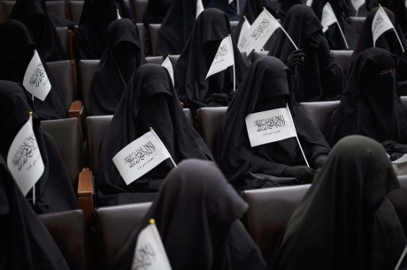 Kabul: Women wave Taliban flags as they sit inside an auditorium at Kabul University's education center during a demonstration in support of the Taliban government in Kabul, Afghanistan, Saturday, Sept. 11, 2021.AP/PTI(AP09_11_2021_000092B)