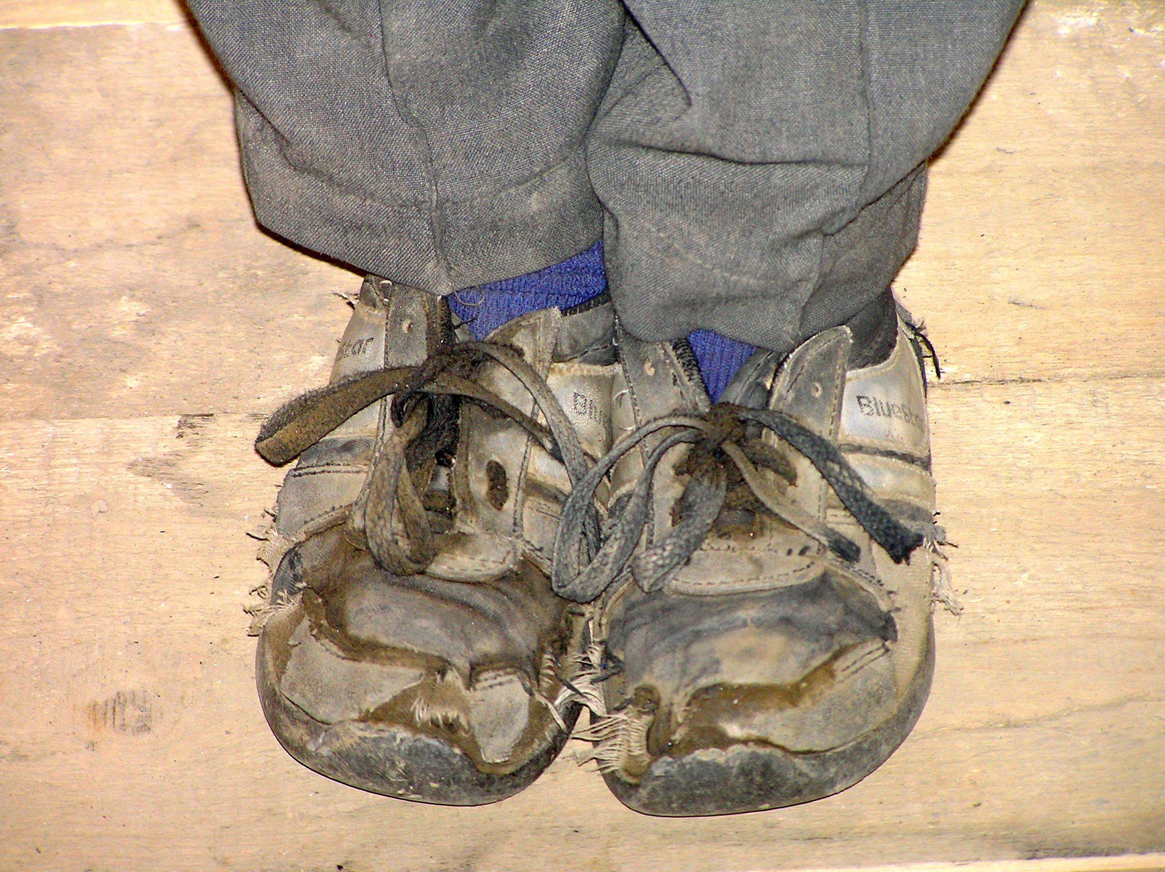 ff48f70db19d Old shoes Iranian boy