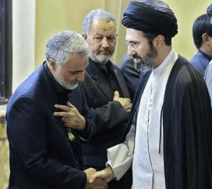 Mojtaba Khamenei (R) with Iranian commander Qassim Soleimani.