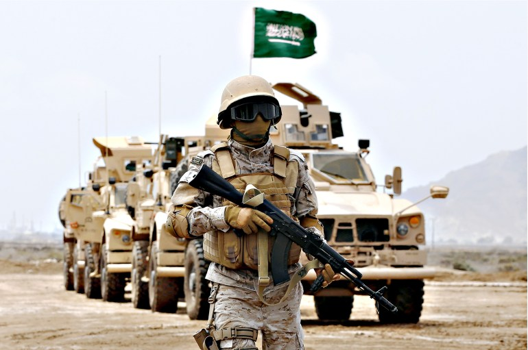 A member of the Saudi forces stands to a...A member of the Saudi