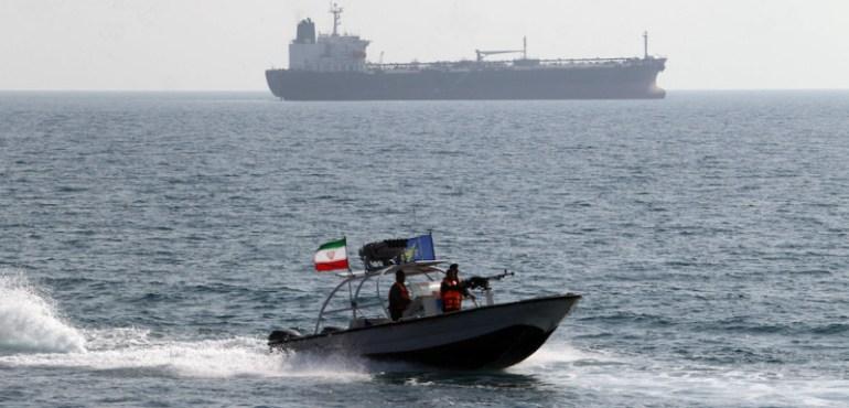 Iranian Revolutionary Guards drive a spe