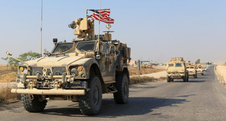 A convoy of U.S. vehicles is seen after withdrawing from northern Syria, on the outskirts of Dohuk